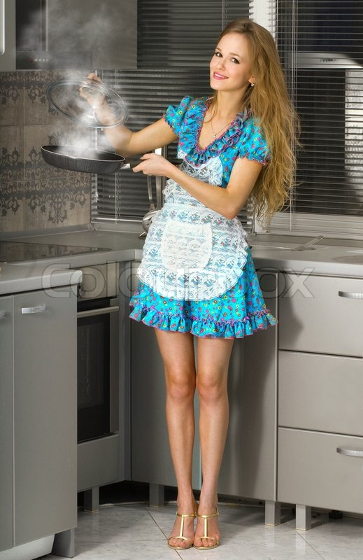 1781556-housewife-with-hot-frying-pan-in-the-kitchen