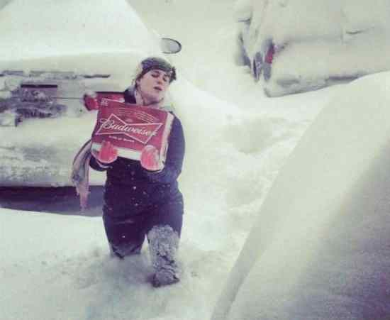 super-wife-carrying-beer-snowstorm